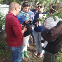 Arava Institute staff and students meet with the family outside of their new greywater system as part of a cost benefit analysis of the greywater project in the West Bank.