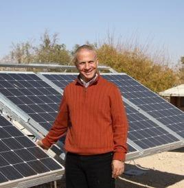 Dr. Tareq Abu Hamed in front of solar panels